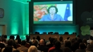 Delegates in St. George's Hall, Dublin Castle, watching a video address from Mrs. Neelie Kroes, Vice-President of the European Commission
